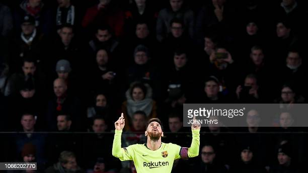 TOPSHOT Barcelona's Argentine forward Lionel Messi celebrates after scoring during the UEFA Champions League football match between PSV Eindhoven and...