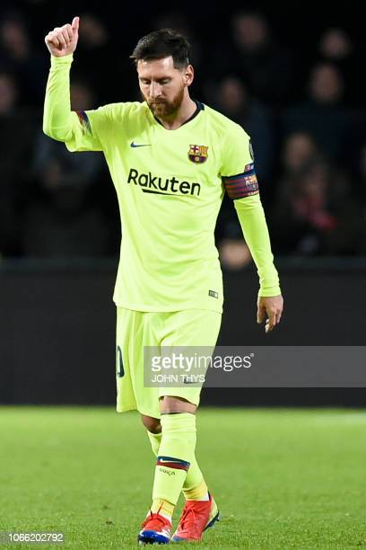 Barcelona's Argentine forward Lionel Messi celebrates after scoring during the UEFA Champions League football match between PSV Eindhoven and FC...