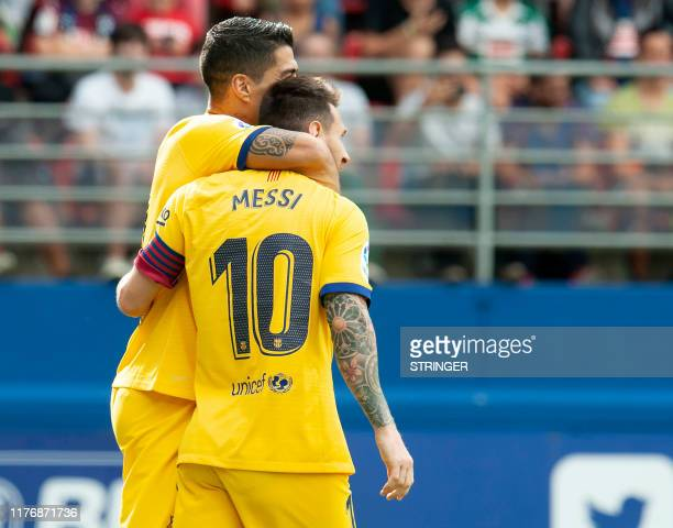Barcelona's Argentine forward Lionel Messi celebrates after scoring during the Spanish league football match SD Eibar against FC Barcelona at the...