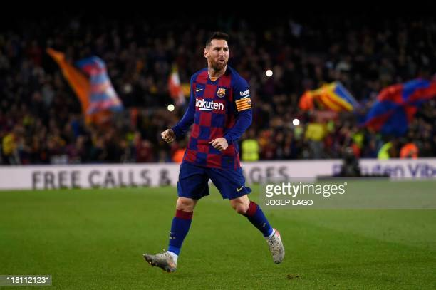 Barcelona's Argentine forward Lionel Messi celebrates after scoring during the Spanish league football match between FC Barcelona and RC Celta de...