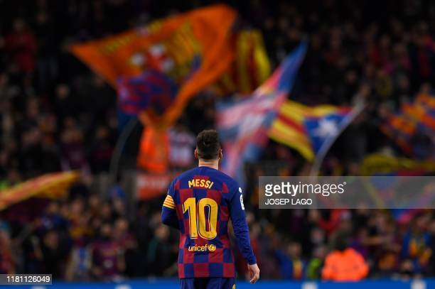 TOPSHOT Barcelona's Argentine forward Lionel Messi celebrates after scoring during the Spanish league football match between FC Barcelona and RC...