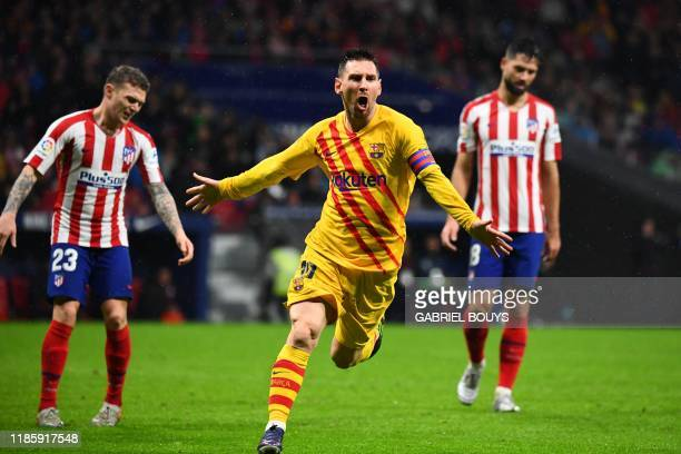 TOPSHOT Barcelona's Argentine forward Lionel Messi celebrates after scoring during the Spanish league football match between Club Atletico de Madrid...