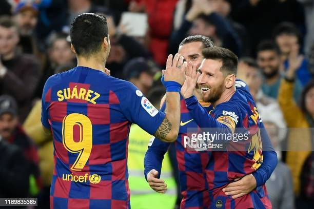 TOPSHOT Barcelona's Argentine forward Lionel Messi celebrates after scoring during the Spanish league football match FC Barcelona against Deportivo...