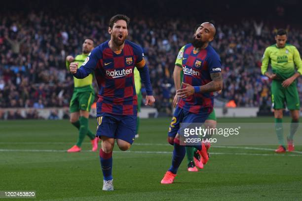 Barcelona's Argentine forward Lionel Messi celebrates after scoring during the Spanish league football match FC Barcelona against SD Eibar at the...