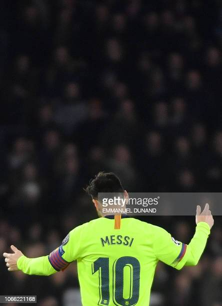 Barcelona's Argentine forward Lionel Messi celebrates during the UEFA Champions League football match between PSV Eindhoven and FC Barcelona at...