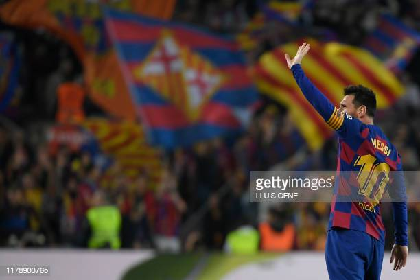 Barcelona's Argentine forward Lionel Messi celebrates his goal during the Spanish league football match between FC Barcelona and Real Valladolid FC...