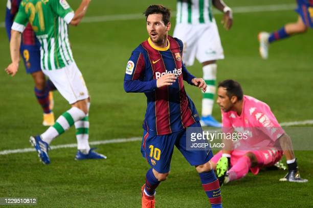 Barcelona's Argentine forward Lionel Messi celebrates his second goal during the Spanish League football match between Barcelona and Real Betis at...
