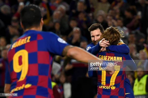 Barcelona's Argentine forward Lionel Messi celebrates with teammate Barcelona's French forward Antoine Griezmann after scoring a goal during the UEFA...