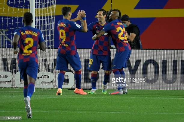 TOPSHOT Barcelona's Argentine forward Lionel Messi celebrates with teammates after scoring a penalty during the Spanish league football match FC...