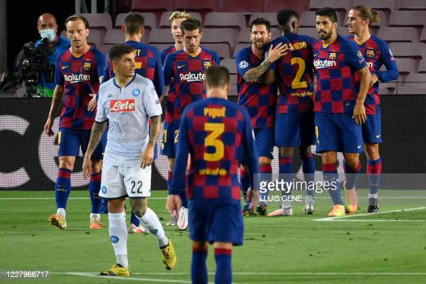 Barcelona's Argentine forward Lionel Messi celebratres after scoring the third goal that will be disallowed due to a handball during the UEFA...