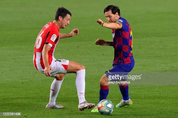 Barcelona's Argentine forward Lionel Messi challenges Athletic Bilbao's Spanish midfielder Mikel Vesga during the Spanish league football match...