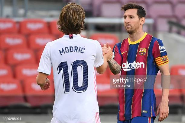 Barcelona's Argentine forward Lionel Messi congratulates Real Madrid's Spanish forward Lucas Vazquez at the end of the Spanish League football match...