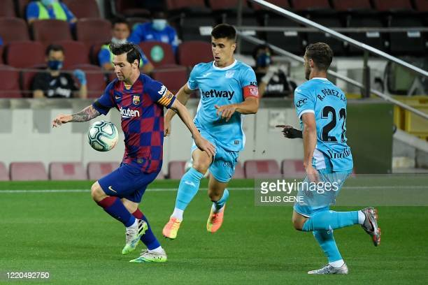 Barcelona's Argentine forward Lionel Messi controls the ball during the Spanish league football match FC Barcelona against CD Leganes at the Camp Nou...