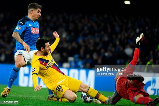 Barcelona's Argentine forward Lionel Messi fouls Napoli's Colombian goalkeeper David Ospina leading to a yellow card during the UEFA Champions League...