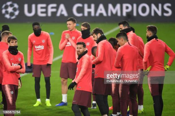 Barcelona's Argentine forward Lionel Messi gathers with teammates during a training session at Philips stadium in Eindhoven on November 27 2018 on...
