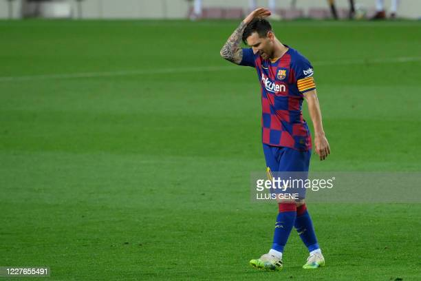 TOPSHOT Barcelona's Argentine forward Lionel Messi gestures during the Spanish League football match between FC Barcelona and CA Osasuna at the Camp...