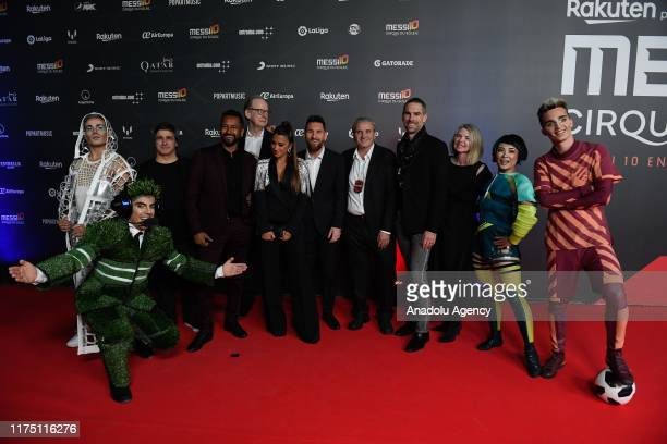 Barcelona's Argentine forward Lionel Messi, his wife Antonella Roccuzzo and other Cirque du Soleil creation team's members pose for a photo on the...