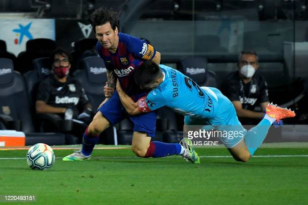 TOPSHOT Barcelona's Argentine forward Lionel Messi is tackled by Leganes' Spanish defender Unai Bustinza during the Spanish league football match FC...