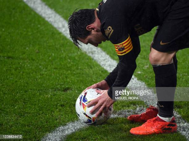 Barcelona's Argentine forward Lionel Messi places the ball to take a corner during the Spanish league football match RC Celta de Vigo against FC...