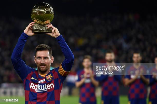 Barcelona's Argentine forward Lionel Messi poses with his sixth Ballon d'Or before the Spanish League football match between FC Barcelona and RCD...