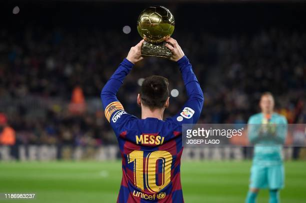 TOPSHOT Barcelona's Argentine forward Lionel Messi poses with his sixth Ballon d'Or before the Spanish League football match between FC Barcelona and...