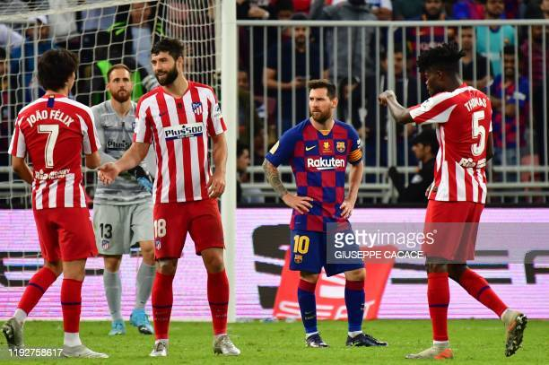 Barcelona's Argentine forward Lionel Messi react to the loss following the Spanish Super Cup semi final between Barcelona and Atletico Madrid on...