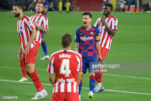 Barcelona's Argentine forward Lionel Messi reacts after missing a goal opportunity during the Spanish League football match between FC Barcelona and...