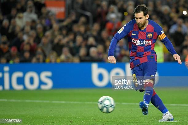 Barcelona's Argentine forward Lionel Messi scores a penalty during the Spanish league football match between FC Barcelona and Real Sociedad at the...