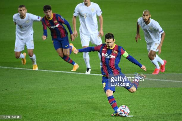 Barcelona's Argentine forward Lionel Messi scores a penalty during the UEFA Champions League football match between FC Barcelona and Ferencvarosi TC...