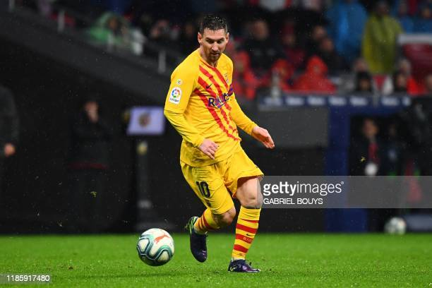 Barcelona's Argentine forward Lionel Messi scores during the Spanish league football match between Club Atletico de Madrid and FC Barcelona at the...