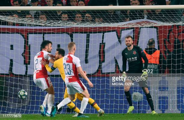 Barcelona's Argentine forward Lionel Messi scores the 0-1 against Slavia Prague's Czech goalkeeper Ondrej Kolar during the UEFA Champions League...