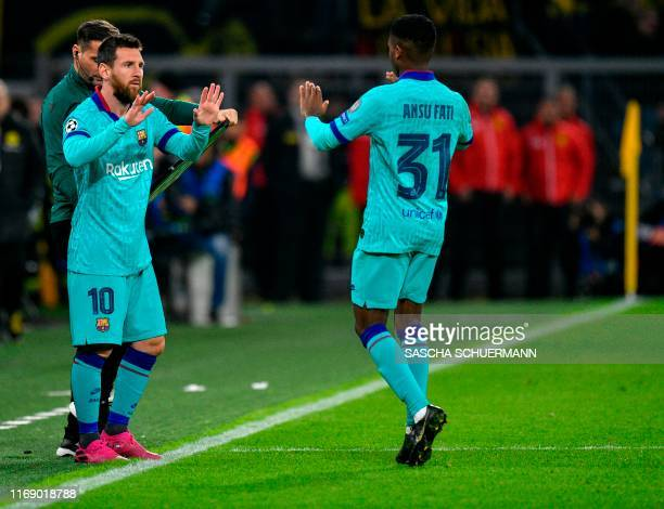 Barcelona's Argentine forward Lionel Messi substitutes Barcelona´s GuineaBissau forward Ansu Fati during the UEFA Champions League Group F football...
