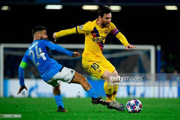 Barcelona's Argentine forward Lionel Messi vies for the ball with Napoli's Italian forward Lorenzo Insigne during the UEFA Champions League round of...