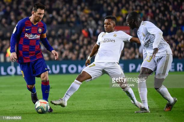 Barcelona's Argentine forward Lionel Messi vies with Real Madrid's Brazilian forward Rodrygo and Real Madrid's French defender Ferland Mendy during...