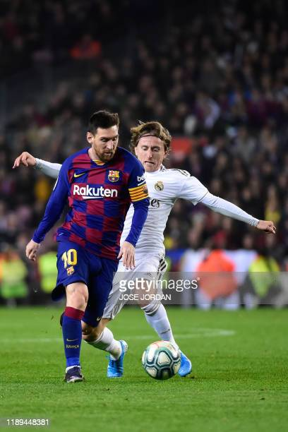 """Barcelona's Argentine forward Lionel Messi vies with Real Madrid's Croatian midfielder Luka Modric during the """"El Clasico"""" Spanish League football..."""