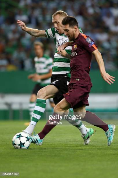Barcelona's Argentine forward Lionel Messi vies with Sporting's defender Jeremy Mathieu from France during the UEFA Champions League football match...