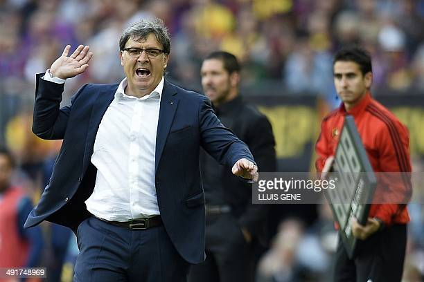 Barcelona's Argentinian coach Gerardo Tata Martino reacts during the Spanish league football match FC Barcelona vs Club Atletico de Madrid at the...