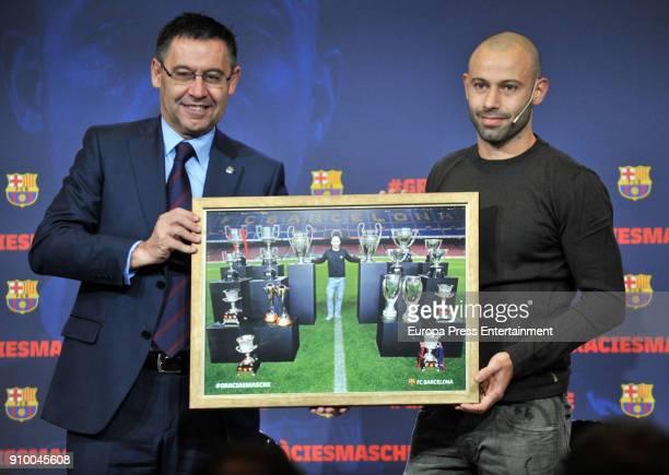 Barcelona's Argentinian defender Javier Mascherano and Josep Maria Bartomeu during a farewell ceremony in Barcelona ahead of Mascherano's transfer to...