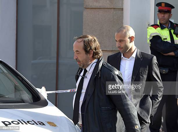 Barcelona's Argentinian defender Javier Mascherano and one of his lawyers leave the courthouse in the coastal town of Gava on October 29 2015 after...