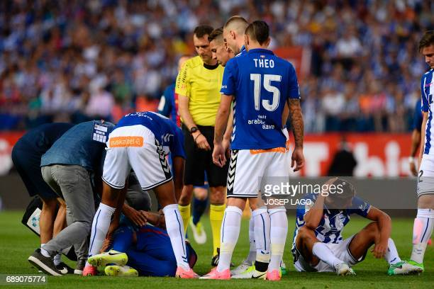 Barcelona's Argentinian defender Javier Mascherano gestures on the pitch after being injured by Deportivo Alaves' midfielder Marcos Llorente during...