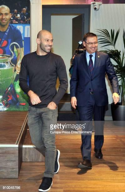 Barcelona's Argentinian defender Javier Mascherano Josep Maria Bartomeu during a farewell ceremony in Barcelona ahead of Mascherano's transfer to...