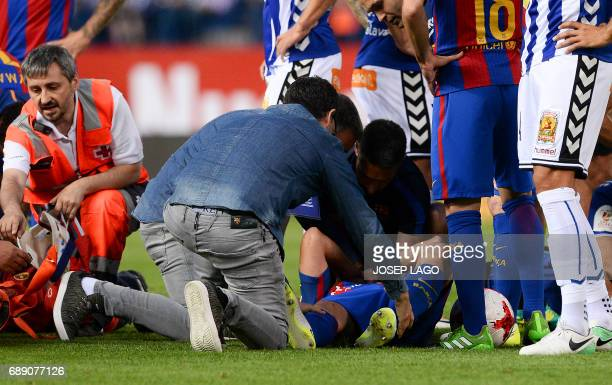Barcelona's Argentinian defender Javier Mascherano lies on the pitch after being injured during the Spanish Copa del Rey final football match FC...