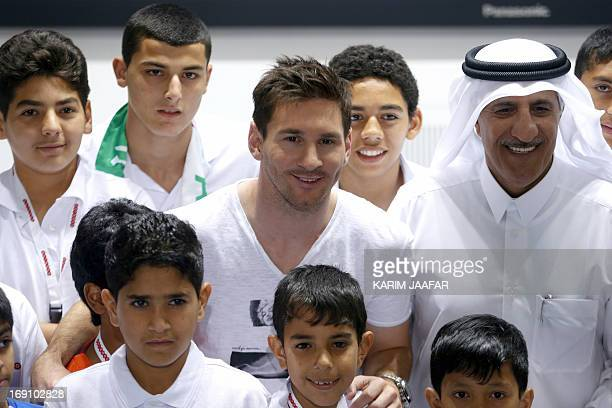Barcelona's Argentinian football player Lionel Messi and Qatari Sheikh Abdullah Bin Mohammed Bin Saud AlThani Chairman of the Board of Directors of...