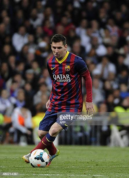 Barcelona's Argentinian forward Leo Messi controls the ball during the Spanish league 'Clasico' football match Real Madrid CF vs FC Barcelona at the...