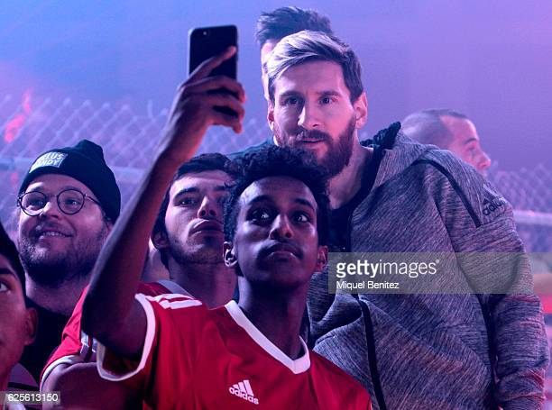 Barcelona's Argentinian forward Lionel 'Leo' Messi poses for a selfie in front of a smartphone during presentation of the new Messi 16 boots by...