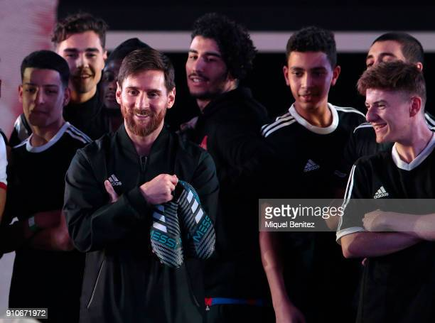 Barcelona's Argentinian forward Lionel 'Leo' Messi poses with his new Nemesis Messi boots by Adidas at Palau Sant Jordi in Barcelona on January 26...