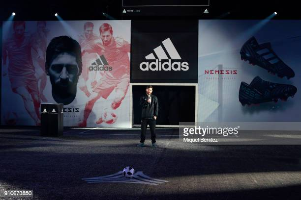Barcelona's Argentinian forward Lionel 'Leo' Messi presents his new Nemesis Messi boots by Adidas at Palau Sant Jordi in Barcelona on January 26 2018...