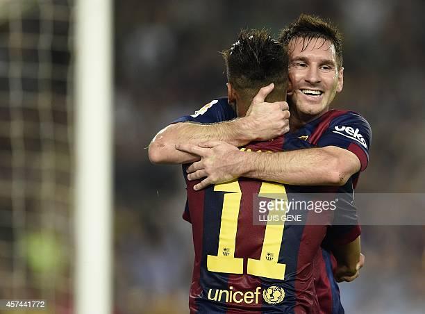 Barcelona's Argentinian forward Lionel Messi and Barcelona's Brazilian forward Neymar da Silva Santos Junior celebrate after scoring a goal during...