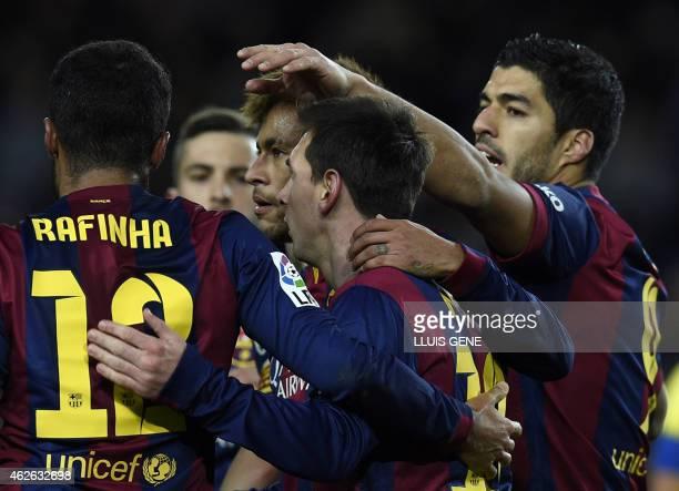 Barcelona's Argentinian forward Lionel Messi and Barcelona's Brazilian forward Neymar da Silva Santos Junior , Barcelona's Uruguayan forward Luis...