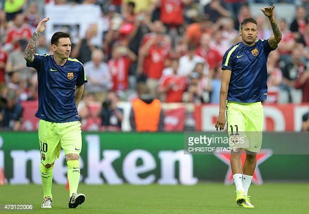 Barcelona's Argentinian forward Lionel Messi and Barcelona's Brazilian forward Neymar da Silva Santos Junior warm up prior to the UEFA Champions...